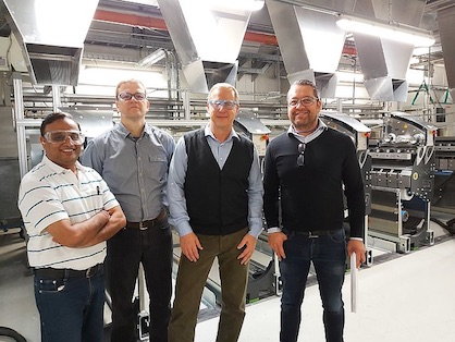 The new POY spinning machine with (from left to right) Sandeep Onkar (IVL), Christian Schneider, Thomas Rademacher, Andre Altmann (all Trevira GmbH) (c) 2019 Trevira