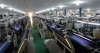 Weaving machine at Vietnam-based Tuong Long, the first denim manufacturer in Vietnam to switch 100% of its production to Archroma's aniline-free* Denisol® Pure Indigo.