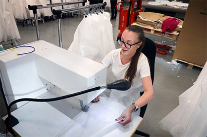 """Jessica Eckerström usually works at ACG Group's Eskil printing plant, which has reduced order intake She is now working on the production of protective garments. """"It great to be able to help, and fun too,"""" she says. Image courtesy of BoråsTidning. (c) 2020 TMAS"""
